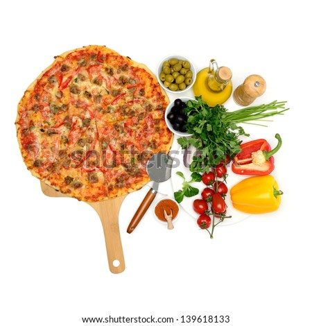 Still life. Homemade pizza and vegetables on the white table. - stock photo