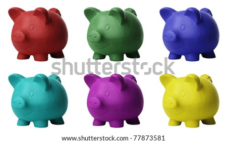 still life image of  different coloured piggy banks - stock photo
