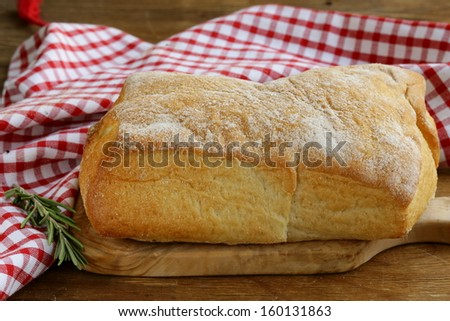 still life in the Italian style - ciabatta bread on a wooden table - stock photo