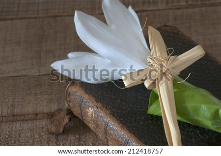 Still Life of a Bible book, Cross, and Hosta Lily.  Horizontal closeup from above and looking down - stock photo