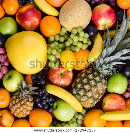 still life of big  heap multi-coloured fruits,  background - stock photo