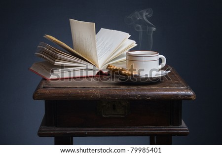 Still life of books and a cup of coffee. - stock photo