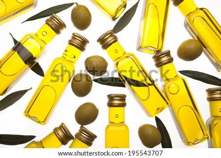 still life of bottles of olive oil with olives - stock photo