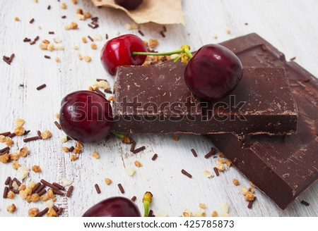 Still life of broken chocolate bar  on wooden table - stock photo