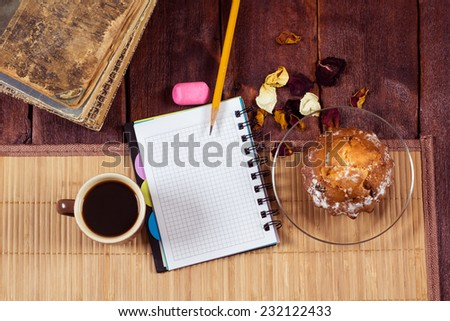 Still life of coffee, muffin, notepad and old books. Workplace literary critic, designer, editor, writer. The concept of starting a new business, a break in work. - stock photo
