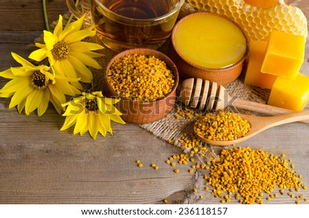Still life of cup of tea, honey, wax and pollen granule - stock photo