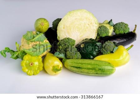 still life of fresh vegetables on white background - stock photo