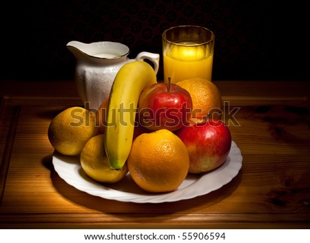 still life of fruit, a cup with juice and milk jug - stock photo
