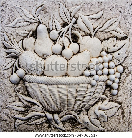 Still life of fruit carved in stone - stock photo