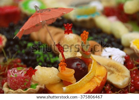 Still life of fruit - Peach, banana, currant, fruit jelly, corn sticks and other. Still life of fruit. - stock photo
