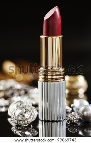 still life of jewelry  and high end lipstick - stock photo