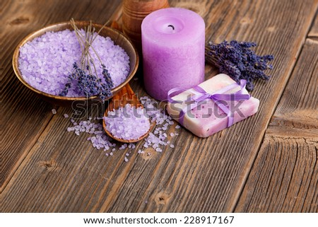 Still life of lavender flower, bath salt, soap and candles  - stock photo