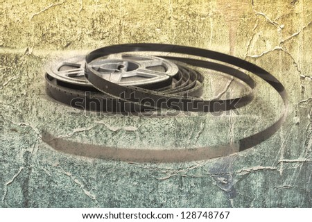 Still life of 8mm cine film reels over a grunge background - stock photo