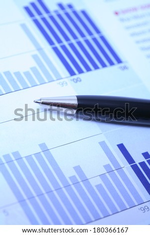 Still life of pen and stats - stock photo