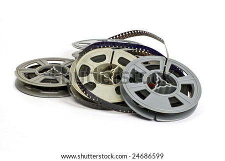 still life of random group of dirty, old 8mm cine film and reels; isolated on white ground - stock photo