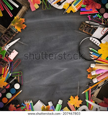 Still life of school tools and books with blackboard on background - stock photo