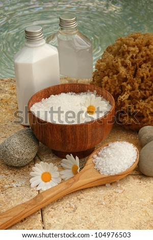 Still life of spa products, flowers and bath salts - stock photo