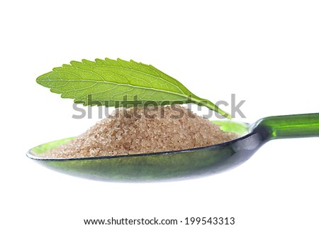 Still life of  Stevia leaf with spoon of brown sugar - stock photo