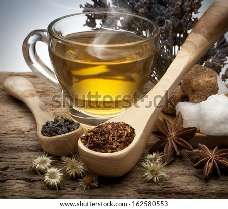 Still life of tea cup and tea varieties - stock photo