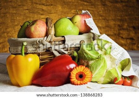 Still Life Of Vegetables And Fruits With Basket. - stock photo