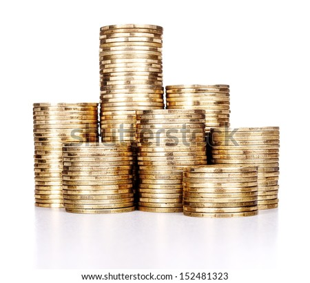 still life of very many rouleau gold monetary or change coin, on dark blue background - stock photo