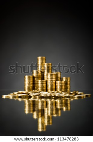 still life of very many rouleau gold  monetary or change coin, on grey background, vertical photo - stock photo