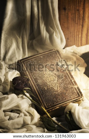 Still life. Old book and rose. - stock photo