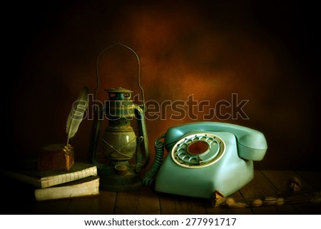 still life old telephone and old lamp ,old wood background - stock photo