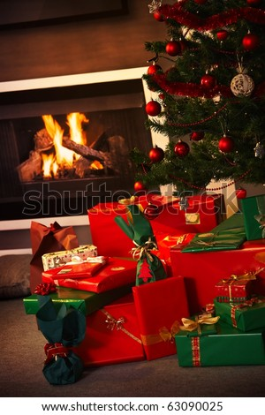 Still life photo of christmas presents and christmas tree in the living room.? - stock photo