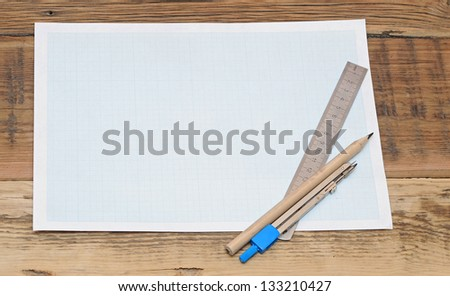 Still life photo of engineering graph paper with pencil, compass and metal ruler blank to add your own design - stock photo