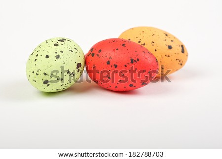 Still life photo of lots of colourful speckled candy covered chocolate easter eggs - stock photo