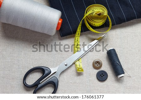 Still life photo of the sewing and handmade with scissors, tape measure, needle - stock photo