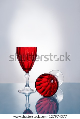 still life photograph of two empty wineglasses on shiny reflective surface - stock photo