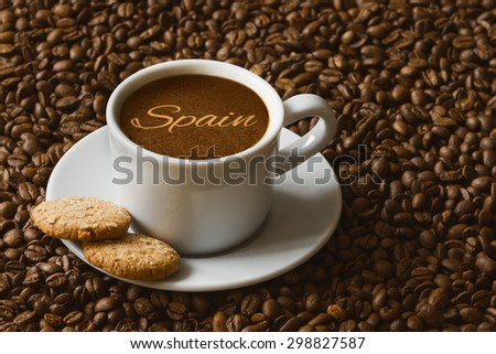 Still life photography of hot coffee beverage with text Spain - stock photo