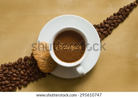 Still life photography of hot coffee beverage wtih text Ethiopia - stock photo
