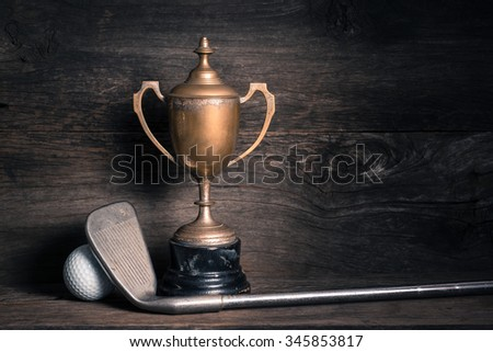 still life photography : old trophy with golf club and ball on old wood - stock photo