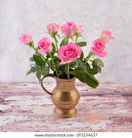Still life. Still life with flowers - pink roses. Still life and rose. Still life and rose in vase. Still life and flowers in vase. Still life on old wooden background. - stock photo