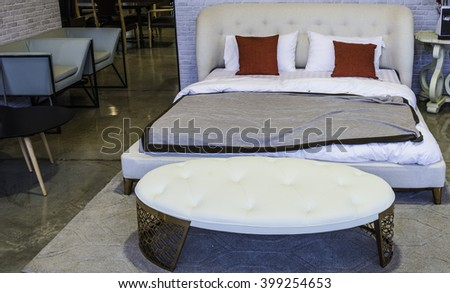 Still life view of an apartment masculine bedroom with wooden furniture in a bright home interior. Comfortable bed room view   headboard, house interior and home living detail. - stock photo