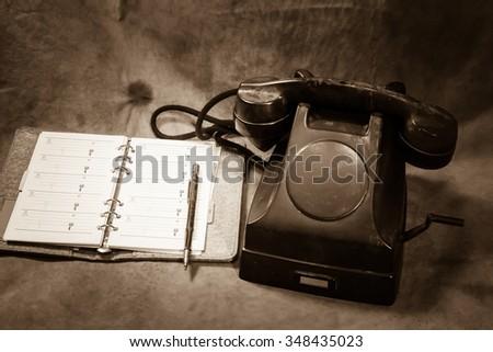 Still life Vintage black phone, Phone Book sepia tone - stock photo