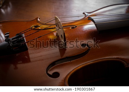 Still life violin on wood table,music instrument. - stock photo