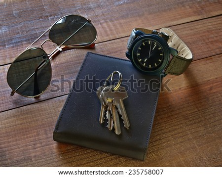 Still life,watch,wallet,keys and sunglasses          - stock photo