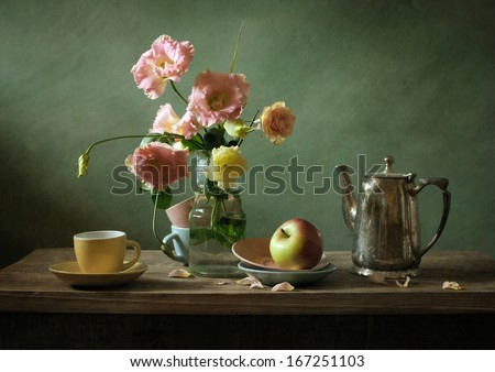 Still life with a beautiful bouquet of flowers and a tea pot - stock photo