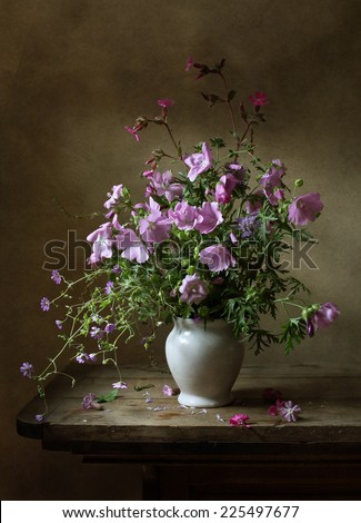 Still life with a beautiful bouquet of summer flowers - stock photo