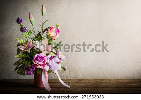 Still life with a beautiful bunch of Flowers with cobweb on wooden table. vintage tone - stock photo