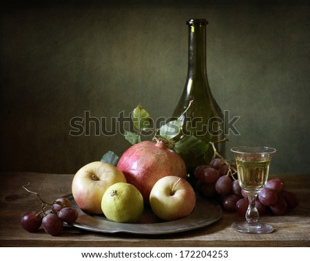 Still life with a bottle of wine and fruit - stock photo