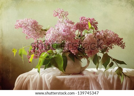 Still life with a bouquet of blooming lilacs - stock photo