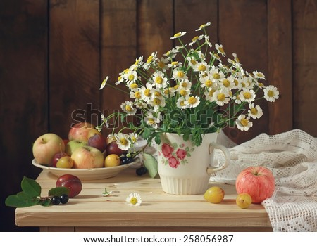 still life with a bouquet of camomiles - stock photo