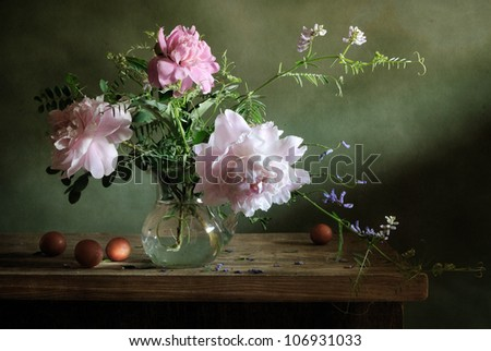 Still life with a bouquet of peonies and apricots - stock photo