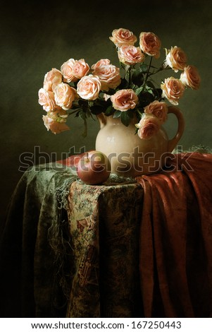 Still life with a bouquet of roses and an apple - stock photo