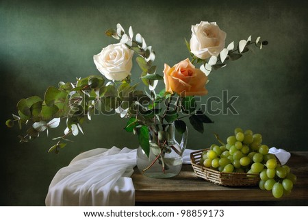 Still life with a bouquet of roses and grapes - stock photo